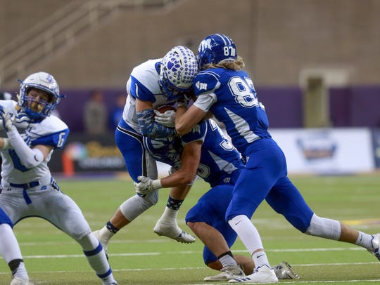 Van Meter's Sam Thompson and Chris Reames (87) tackle