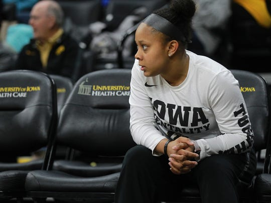 Iowa's Tania Davis watches teammates from the sideline during the Hawkeyes' game against Drake at Carver-Hawkeye Arena on Thursday, Dec. 21, 2017.