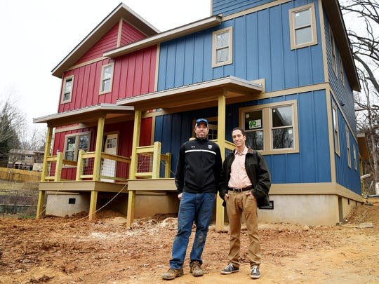 """Kyle Henry, left, and Aaron Palmer, partners in Ground Floor Properties NC, have a nearly finished duplex on State Street. Each 1,100-square-foot unit is selling for $279,000. The plan is to add another eight homes on about two acres behind the duplex, all of them on the small side, ranging from 800 square feet to 1,200 max. """"Nothing will be above $300,000,"""" Henry said. """"We feel pretty comfortable being below that number, because that's where the majority of the buyers are."""""""