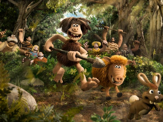 Dug (center, voiced by Eddie Redmayne) leads the charge