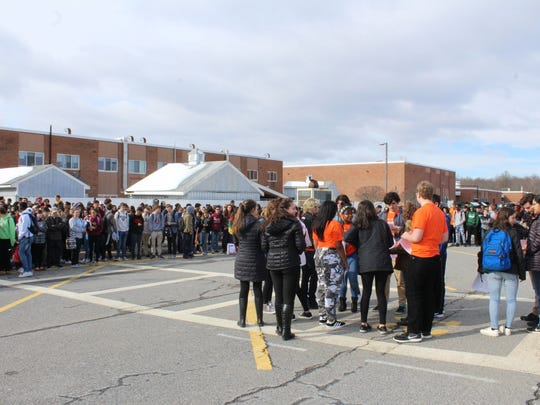 Hundreds of Arlington High Schools students participate in the National School Walkout on Wednesday.