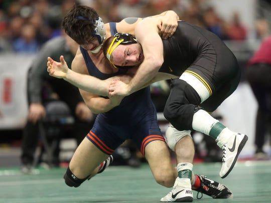 Iowa's Alex Marinelli wrestles Illinois' Isaiah Martinez in the 165 pound semifinals at the NCAA Wrestling Championships at Quicken Loans Arena in Cleveland, Ohio on Friday, March 16, 2018. Marinelli lost by decision, 5-2.