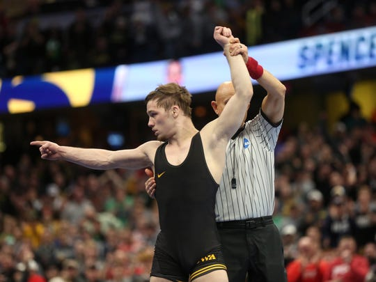 Iowa's Spencer Lee celebrates after winning the 125 pound national championship over Rutgers' Nick Suriano at the NCAA Wrestling Championships at Quicken Loans Arena in Cleveland, Ohio on Saturday, March 17, 2018.