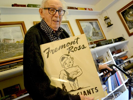 Bob Lorenz holds one of his early sketches of Fremont