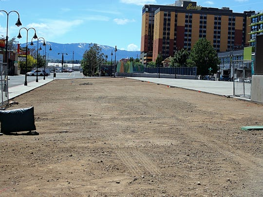 A photograph showing an empty dirt lot between Sierra and West streets on Commercial Row. The site will become The Biggest Little Dog Park, the first dog park to be located in downtown Reno. The park is expected to open mid to late June.