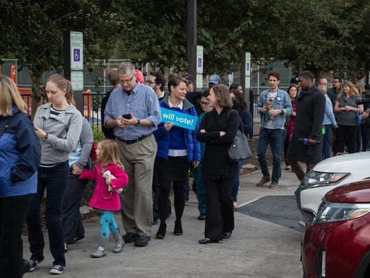 HOUSTON, TX - OCTOBER 22: People wait in line to vote