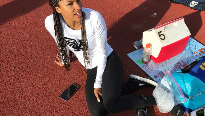 Agoura star Tara Davis ices her ankle after injuring it during warm-ups at the Marmonte League Track and Field Championships on Friday at Westlake High. Davis still managed to win three league titles.