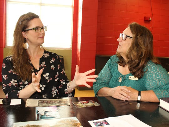 Beana Kuntzman, left, and Cahawba Site Director Linda Derry discuss decades-long efforts by Kuntzman's father, Tommie Coleman, to promote Alabama's first capital city. Alvin Benn/Special to the Advertiser
