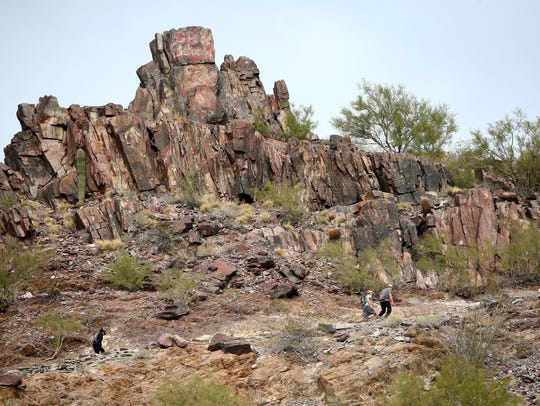 Hikers on the Summit trail at Piestewa Peak in Phoenix