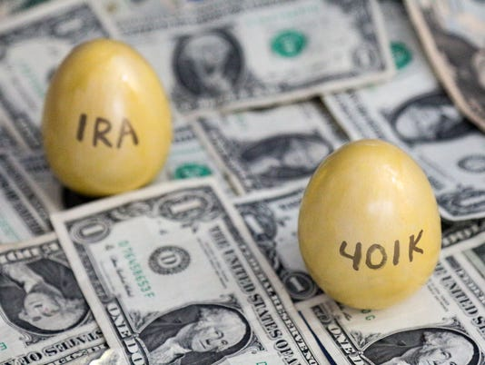 401k and IRA golden eggs on one dollar bills