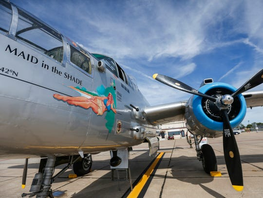 People take pictures and look around the B-25 Warbird