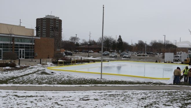 The Oshkosh City Parks Department installs an ice rink outside the Oshkosh Convention Center on Thursday. The ice rink is expected to open in January.