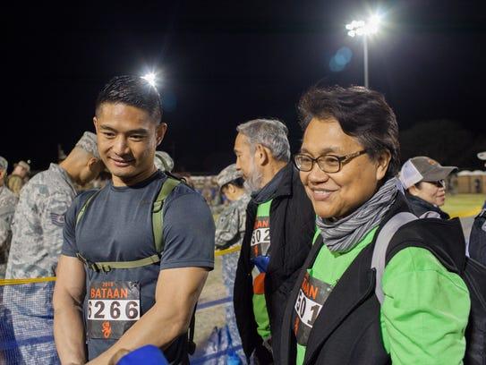 Glenn Rivera (left) and Rowena San (right) talk about