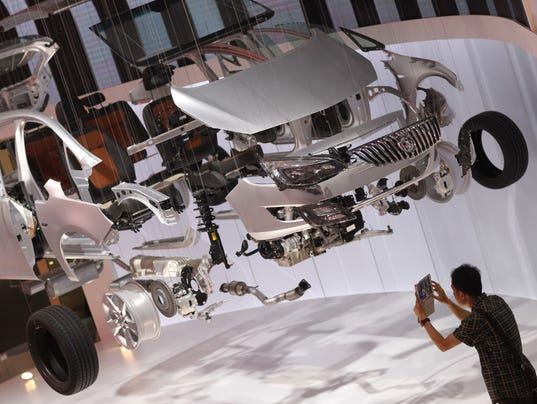 China sales surge for GM, Ford in first half - Photo: STR AFP/Getty Images