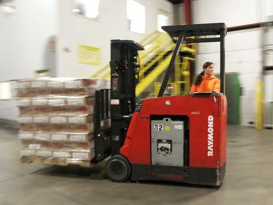 Crystal Ferry,  of Integrity Express Logistics, operates a fork lift loading trucks with J.T.M. Food Group Products at the business in Harrison.