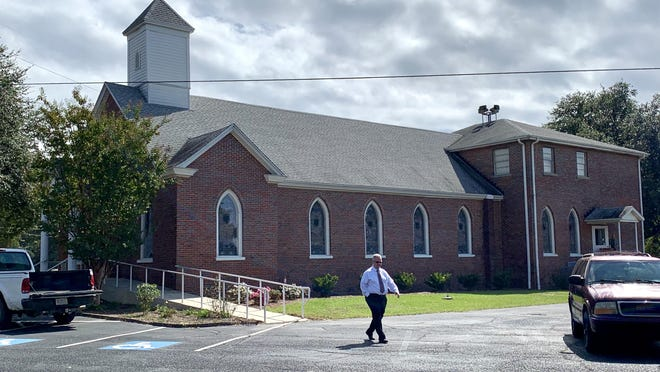 Pastor Steve Cheek walks in front of First Baptist Church Montmorenci in Aiken during the celebration of the church's 150th birthday Sunday, Oct. 18.
