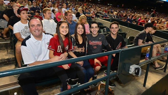 Arizona Diamondbacks president Derrick Hall, wife, Amy, and family enjoy a game at Chase Field in Phoenix, May 23, 2015.
