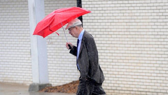 Man walking in the rain.