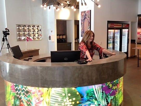 Heide Poole, Aloft Hotel general manager, stands behind