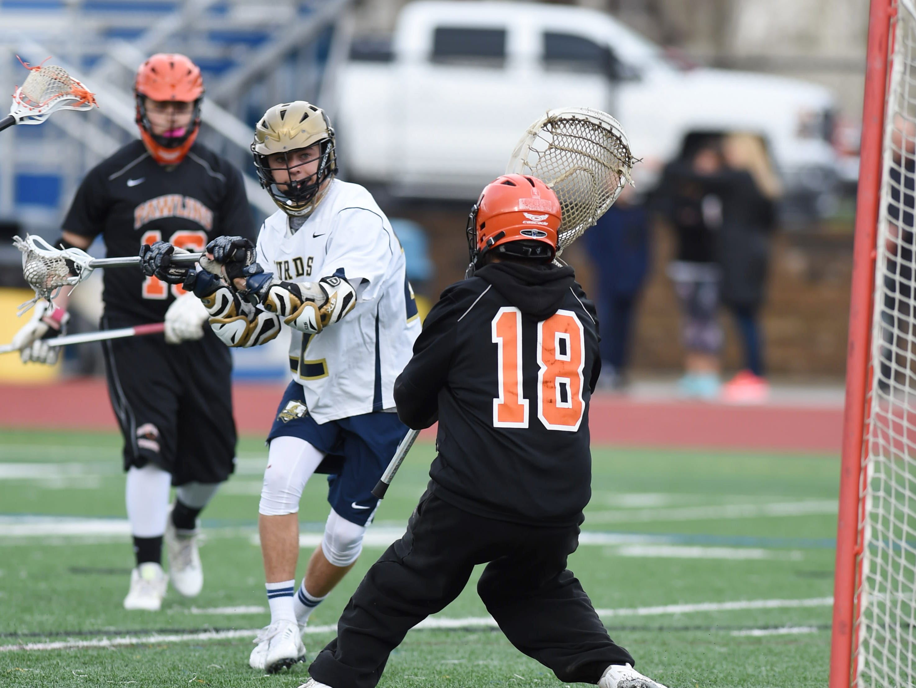 Lourdes' Dillon Rispoli winds up for a shot on Pawling's goalie, Sean Dazi during Thursday's game at Lourdes.