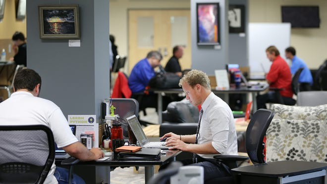 Kurtis Moss, executive director of Launch Fishers, works out of the launch location in the basement of the Fishers Public Library on Aug. 20, 2014.
