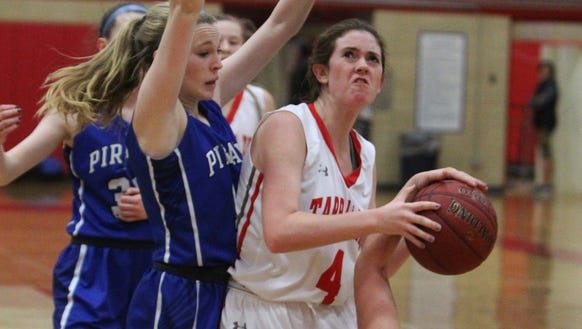Tappan Zee's Fiona Mullen is sandwiched between Pearl River's Meagan Woods, left, and Ashley Rilley during their game at Tappan Zee Jan. 11, 2018.