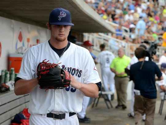 Gulf Breeze native Ben Lively makes his way from the dugout during his debut appearance in June 2014 for the Pensacola Blue Wahoos. He remains only local player to play for the team and was honored last week with bobblehead doll.