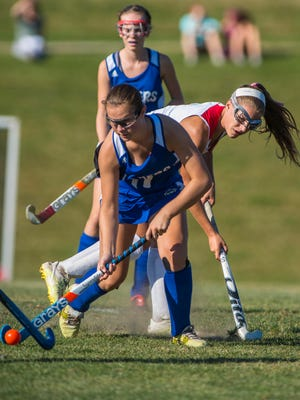 Colchester's Meg Lehouiller, front, is pressured by CVU's Lydia Maitland in Hinesburg on Monday, September 13, 2016.