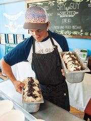 Paul Sansone with freshly-made Young Jamie gelato at Shy Guy Gelato in Burlington on Wednesday, August 9, 2017.  The flavor is vegan and has peanut butter, almond milk and chocolate cookies.