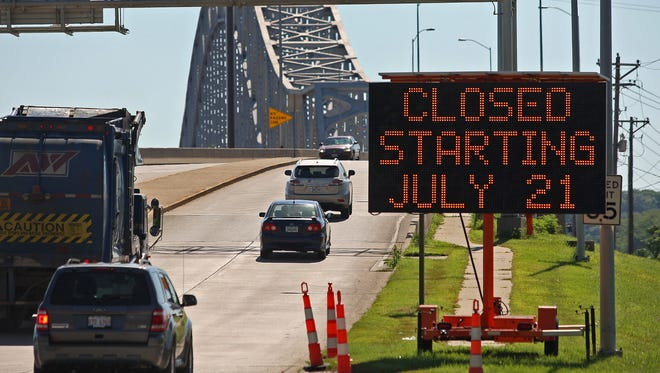 In this Wednesday, July 16, 2014, traffic from Dubuque, Iowa enters the Julien Dubuque Bridge that connects Iowa with Illinois. The bridge will be closed for repairs starting Monday, July 21, 2014.
