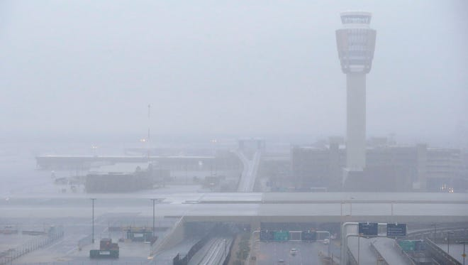 The tower is barley visible during a storm at Sky Harbor International Airport in Phoenix.