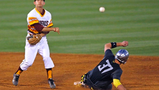 Arizona State infielder Tucker Esmay (3) gets the force out on Oregon infielder Mitchell Tolman (37) to turn a double play and end the second  inning of their NCAA baseball game Saturday, May 10, 2014 in Tempe, Arizona.