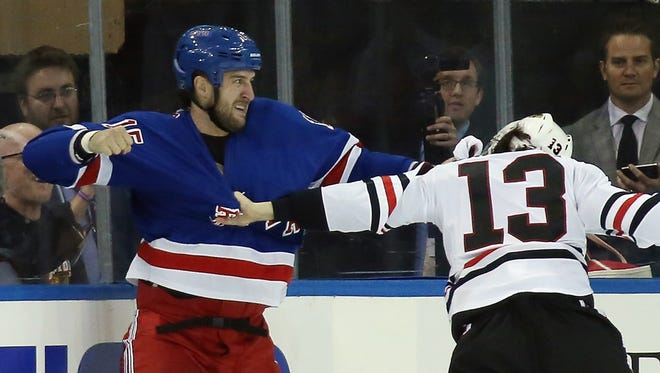 New York Rangers forward Tanner Glass fights with Chicago's Daniel Carcillo on Friday night.