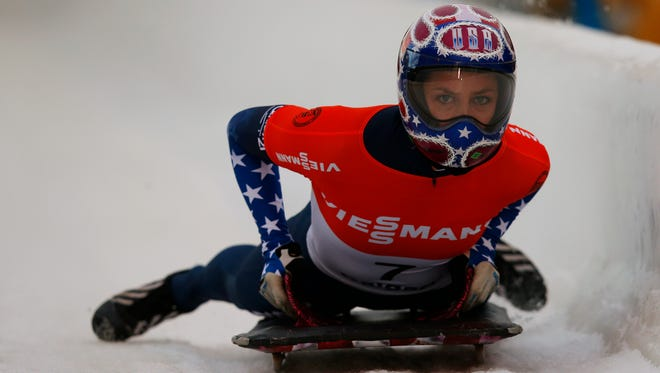 Noelle Pikus-Pace of the U.S. looks for her time after she finished in first place in the women's skeleton race during the 2013 IBSF World Cup in Calgary, Alberta, Canada.