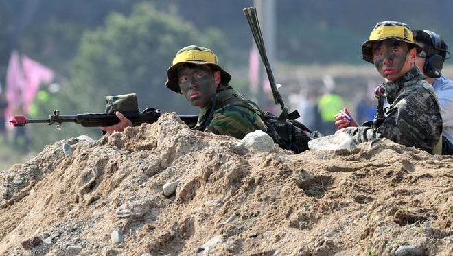 South Korean Marines take a position on a beach during a joint landing exercise with U.S. Marines in Pohang, South Korea, on Monday.