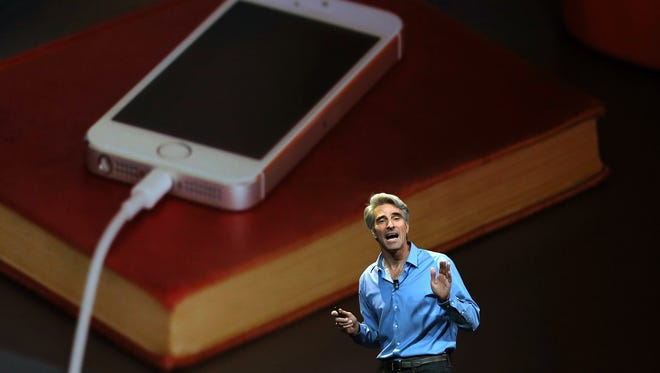 Apple Senior Vice President of Software Engineering Craig Federighi speaks during the Apple Worldwide Developers Conference at the Moscone West center on Monday in San Francisco.