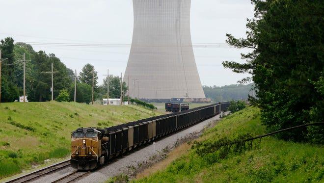 A coal train stops near White Bluff power plant near Redfield, Ark., in 2014.
