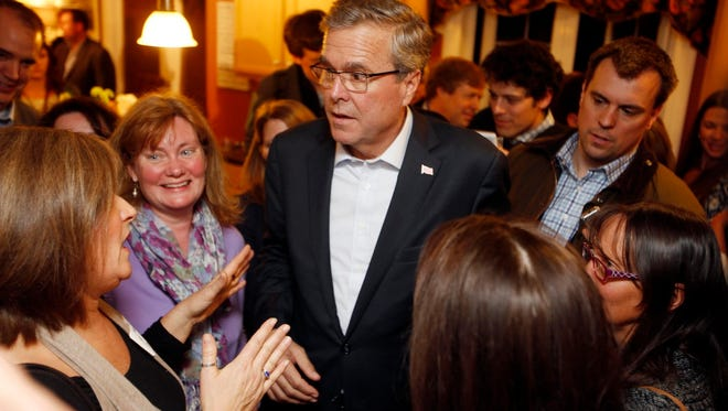 Jeb Bush speaks to New Hampshire residents at a packed Dover house party.