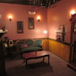 An escape room at Enigma Saturday, April 4, 2015, is set up in Fort Collins, CO. The escape room locks a group of people into a themed room and gives them one hour to figure out puzzles and clues to unlock the door and escape the room.