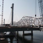 PHOTOS BY Pat McDonogh/The C-J The new downtown bridge is being built with nine piers, four on land and five in the water. Three of the piers include tower supports. The tallest tower is 280 feet high. Work continues on the downtown bridge, as seen during a press tour, Thursday morning.