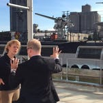 Wisconsin Sen. Tammy Baldwin talks with Manitowoc Mayor Justin Nickels during her tour of the area's waterfront.