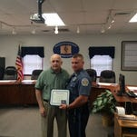 Officer Mario Angelini is presented his award by Ed Boothman, the Pennsylvania Aggressive Driving Law Enforcement Liaison Coordinator Wednesday morning.