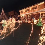 The home of Cathy and Joseph Mahoney in Old Bridge decorated for the 2013 holidays. Visitors who come to see the lights and Santa on Dec. 12 and 13 are asked to bring a toy for the Toys for Tots campaign