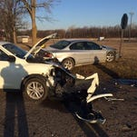 Two people suffered non-life-threatening injuries in a two-car crash this morning in front of Maple Valley High School off Nashville Highway, officials said.