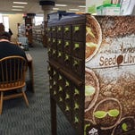 """Patrons can choose up to five free packets of seeds per month from the Mansfield-Richland County Public Library's """"seed library."""""""
