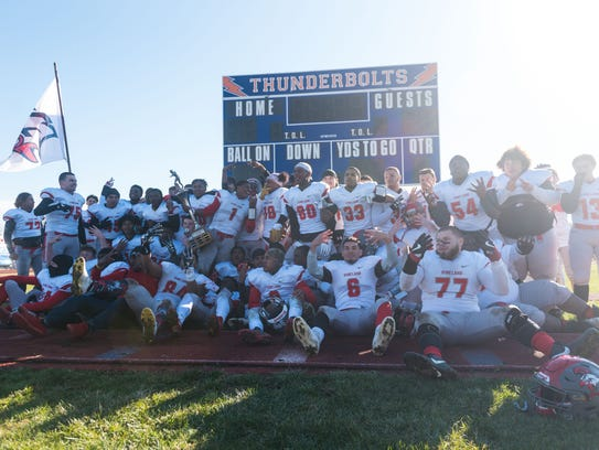 Vineland celebrates a win against Millville at John