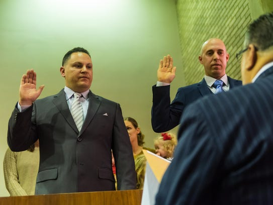 Frank DiNunzio and Thomas Spigelmyer take the oath