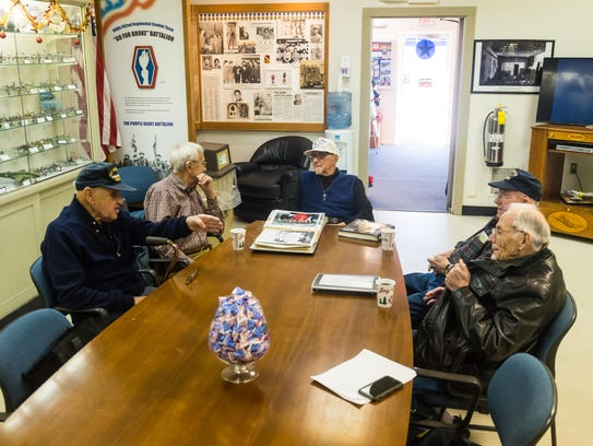 World War II Veterans Owen Garrison, Dick Young, Bob Westcott, Jack Williams and Ed Turner exchange old stories in a meeting of World War II veterans at the Millville Army Air Field Museum on Friday, December 29.