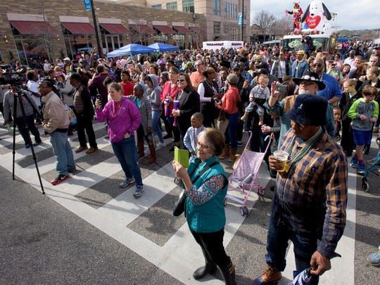 Revelers take part in the Mardi Gras Block Party & Cajun Cook-Off  in downtown Montgomery, Ala. on Saturday February 18, 2017.
