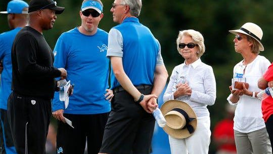 Detroit Lions head coach Jim Caldwell, from left, talks with general manager Bob Quinn, president Rod Wood, owner Martha Ford, and vice chair Sheila Ford Hamp during NFL football practice in Allen Park, Mich., Aug. 1, 2016.